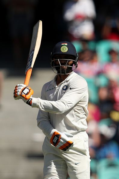 Jadeja with his trademark Swordfight celebration after reaching fifty