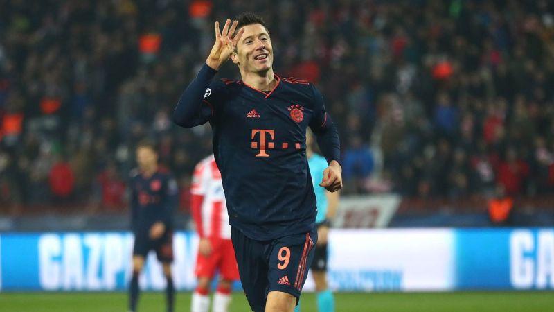Robert Lewandowski gestures after scoring a quadruple at Crvena Zvezda