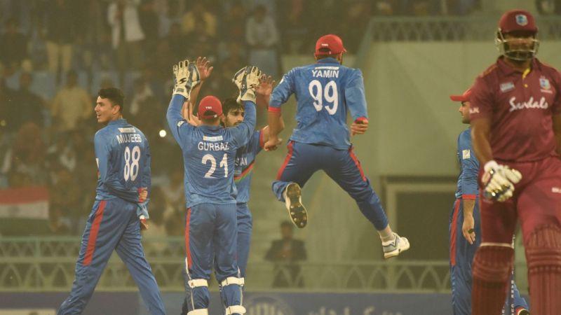 Afghanistan seamer Karim Janat celebrates one of his five wickets