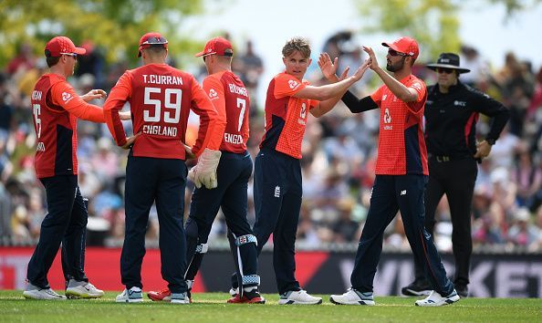 England celebrate the fall of a wicket