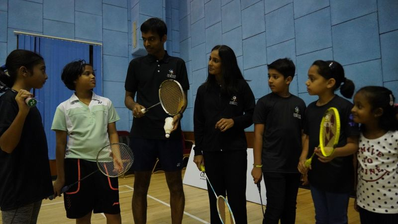 Pullela Gopichand interacts with kids at a badminton clinic, even as Aparna Popat looks on, during the official launch of the Badminton Gurukul at MCA Club in BKC on Thursday.
