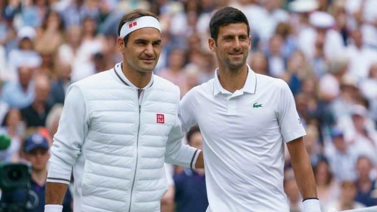 Roger Federer (left) and Novak Djokovic pose before their historic 2019 Wimbledon final