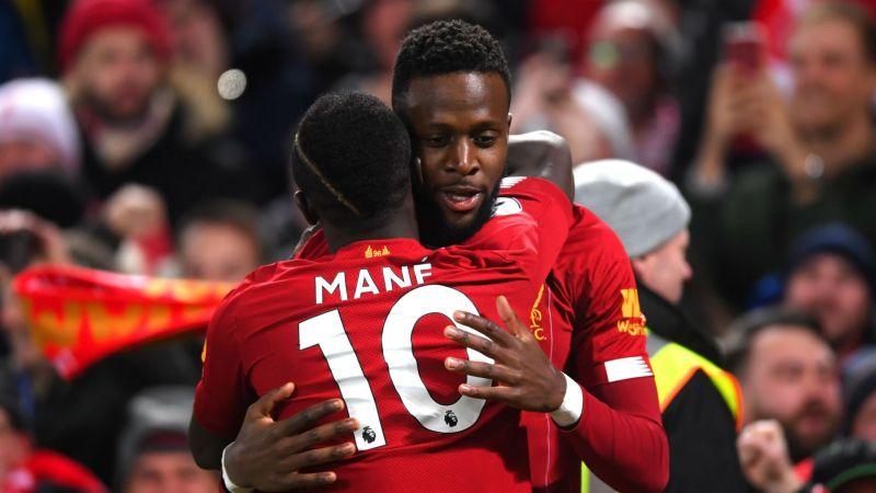 Sadio Mane and Divock Origi celebrate a Liverpool goal against Everton
