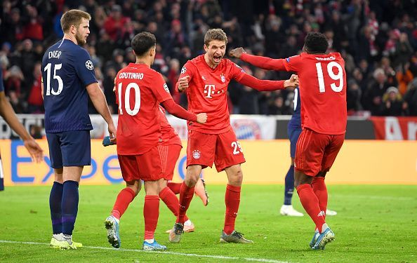 Bayern players celebrate during their 3-1 win over Tottenham, completing their 100% group stage record