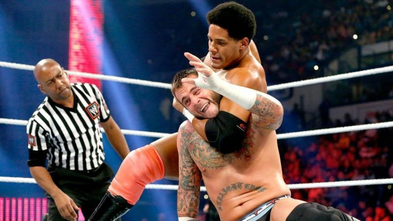Darren Young taking on CM Punk in the ring