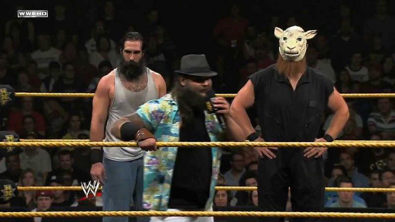 Bray Wyatt(center) with Luke Harper(left) and Erick Rowan(right)