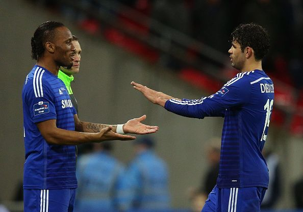 Didier Drogba coming on as a sub for Diego Costa