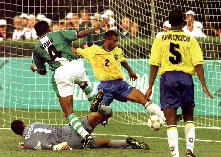 Kanu slots the ball past Dida to give Nigeria victory against Brazil