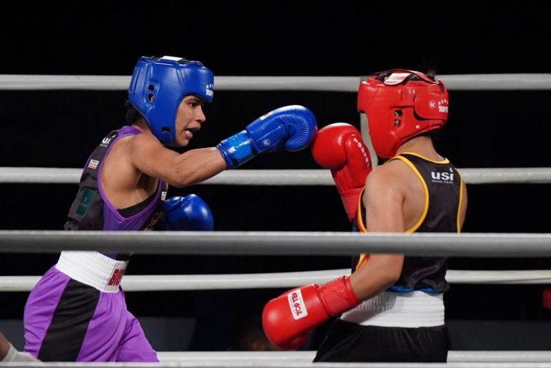 Nikhat Zareen is pictured attempting a punch