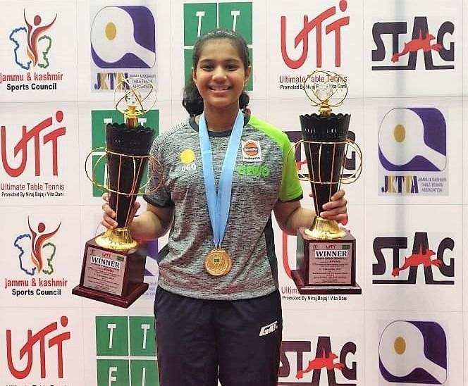 Diya Chitale poses with her awards