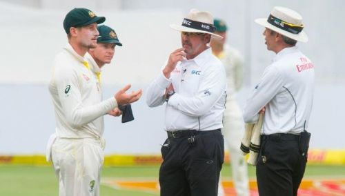Cameron Bancroft being interrogated by on-field umnpires over the ball-tampering incident