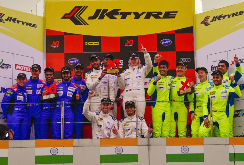 Winners pose on the podium of the inaugural leg of the X1 Racing League.