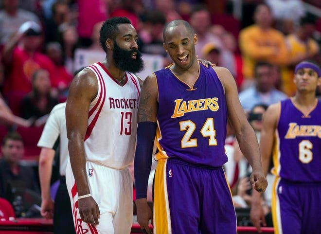 Kobe Bryant and James Harden share a moment during a game.