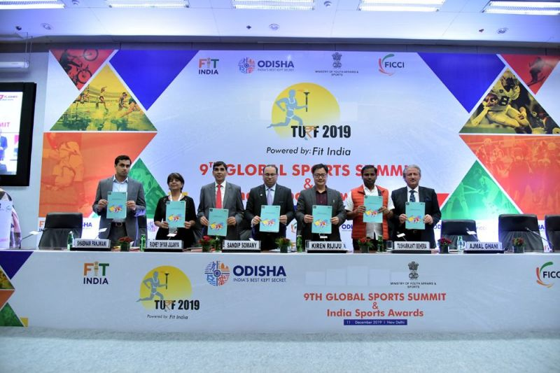 Mr Kiren Rijiju, MoS (I/C) Youth Affairs and Sports, GoI (4th from left); Mr Tusharkanti Behera, MoS, Sports and Youth Affairs, Govt. of Odisha (5th from left); Mr Radhey Shyam Julaniya, Secretary, Department of Sports, GoI (2nd from left); Mr Sandip Somany, President, FICCI (3rd from left); and other dignitaries