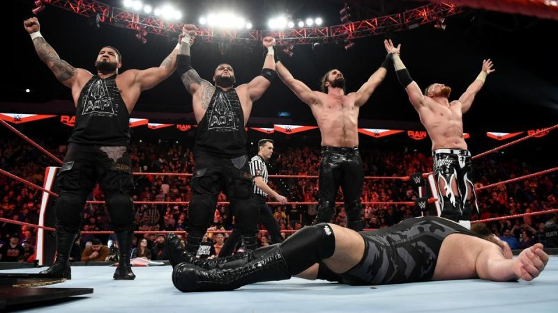 Seth Rollins, Buddy Murphy & AOP stand tall after their victory in the first fist fight in Raw history