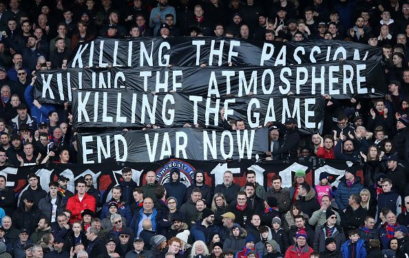 Home fans held banners calling for the removal of VAR at the start of the game