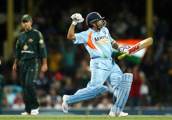 An ecstatic Sachin Tendulkar after reaching his hundred, as Ricky Ponting watches