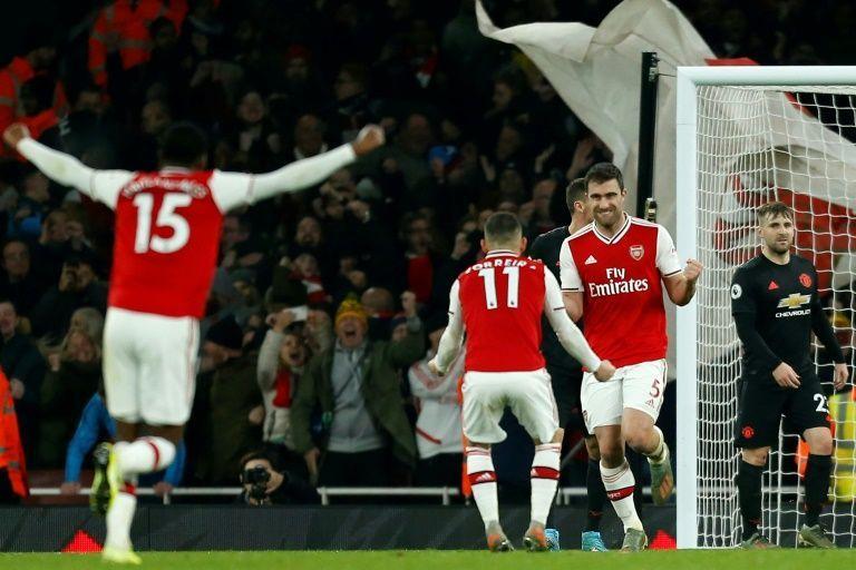 Arsenal players celebrate Sokratis