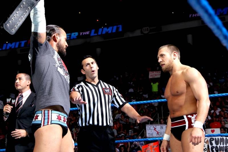CM Punk (left) posing with the WWE Title against Daniel Bryan