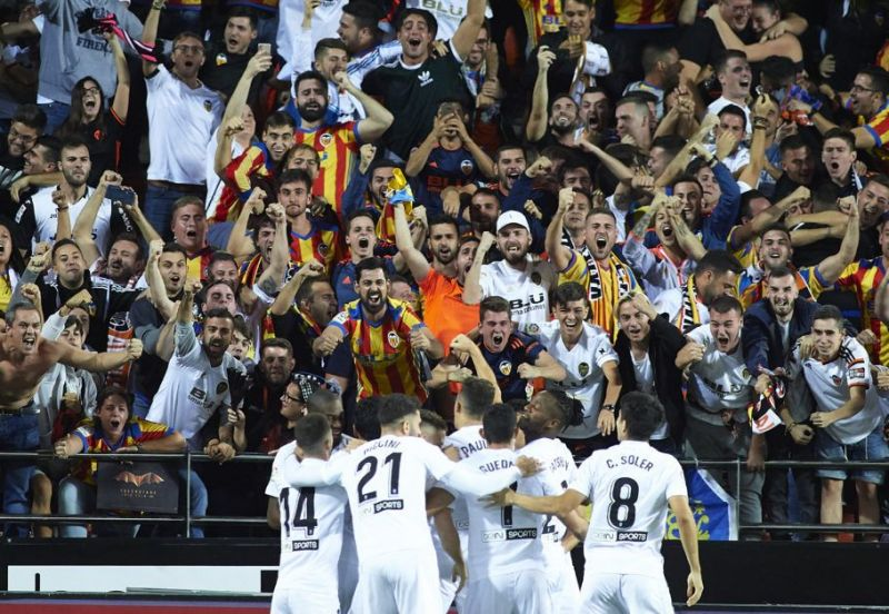 Valencia players celebrating a goal at Mestalla
