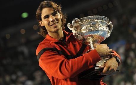 Rafael Nadal hoists aloft the 2009 Australian Open title