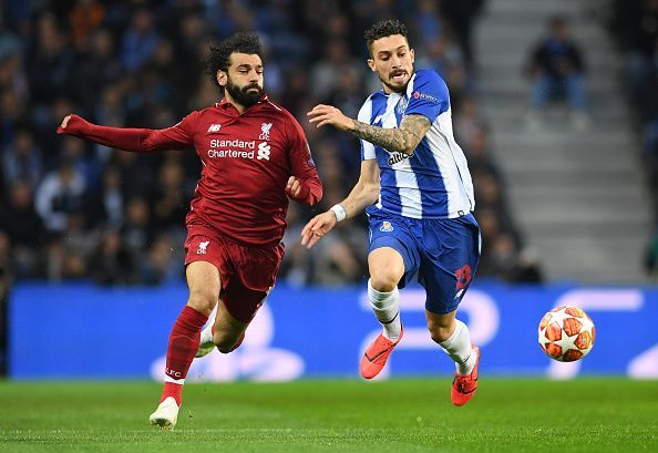 Telles competes with Salah for possession