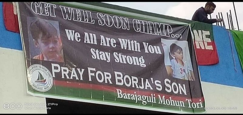 The banner in the field praying for the speedy recovery of Borja Gomez