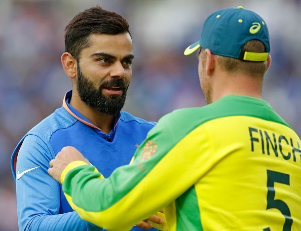 Virat Kohli (left) and Aaron Finch (right)