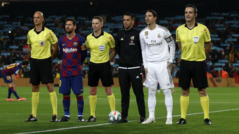 Lionel Messi and Sergio Ramos with match officials - cropped