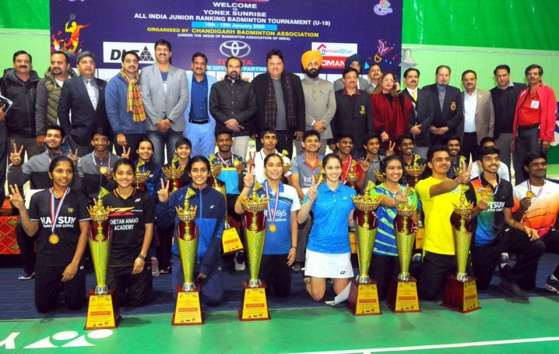 The title winners with their trophies at the Yonex-Sunrise All India Junior Ranking Tournament in Chandigarh