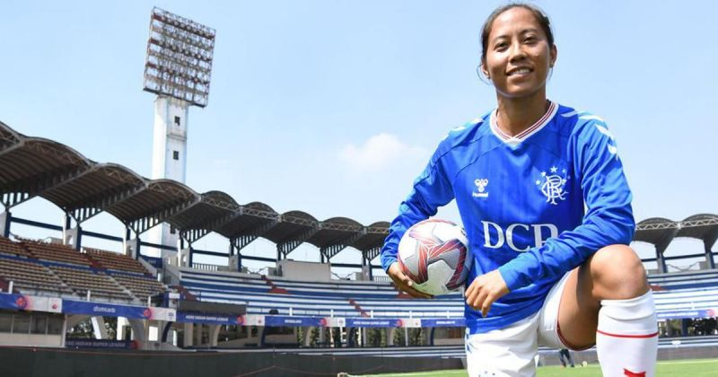 Bala Devi poses at the Kanteerava Stadium following her first press conference as a Rangers player