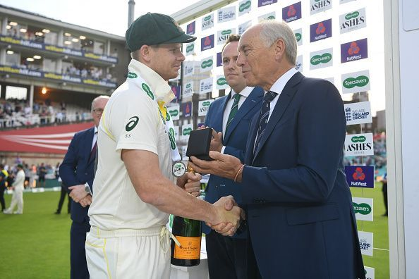 Colin Graves awarding Steve Smith the player of the series award during the 2019 Ashes. Will the Ashes be the same if it was four days?