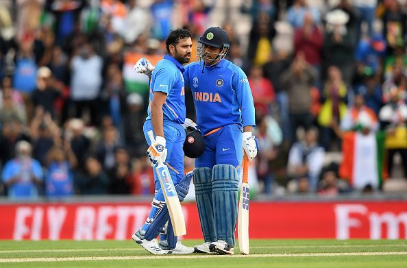 Rohit Sharma celebrates his century against SA with MS Dhoni at the CWC