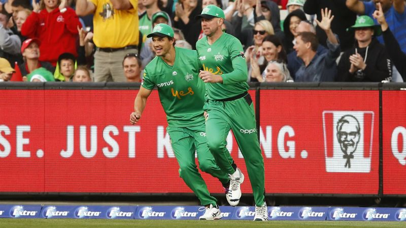 Ben Dunk and Nathan Coulter-Nile celebrate the match-turning catch