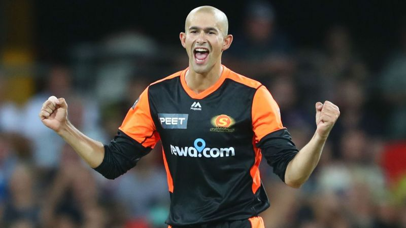 Ashton Agar celebrates a wicket against Brisbane Heat
