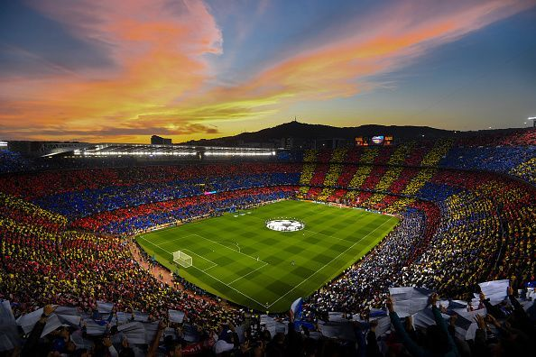 The iconic Camp Nou stadium with Cules holding up the tifo