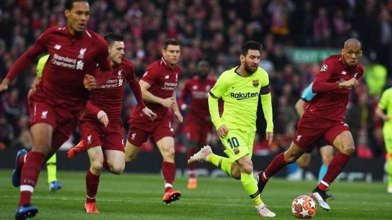 Lionel Messi being chased by a pack of Liverpool