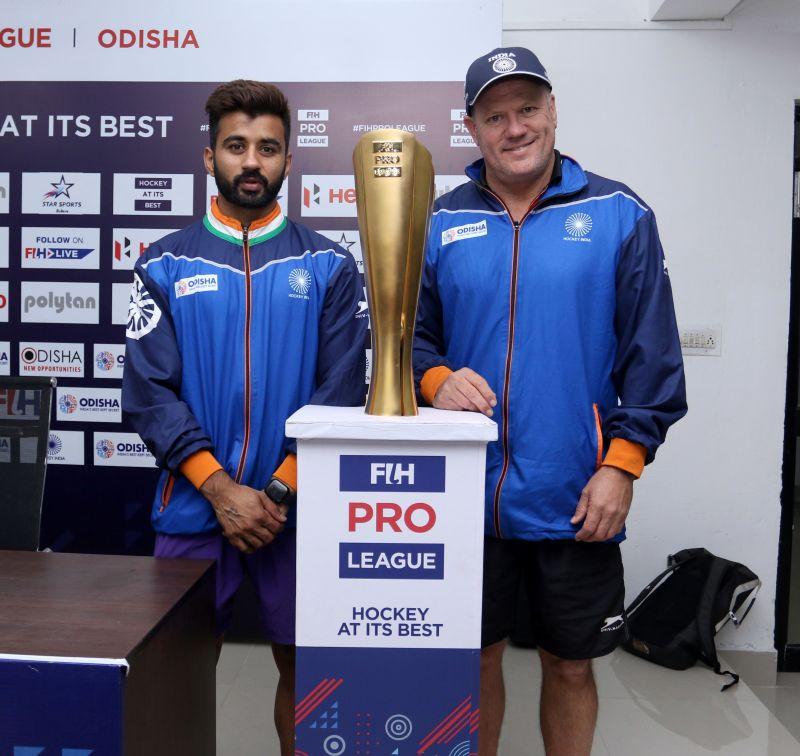 India coach Graham Reid and captain Manpreet Singh with Pro League Trophy