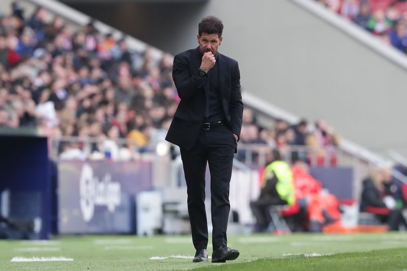 Simeone cautiously patrols his technical area.