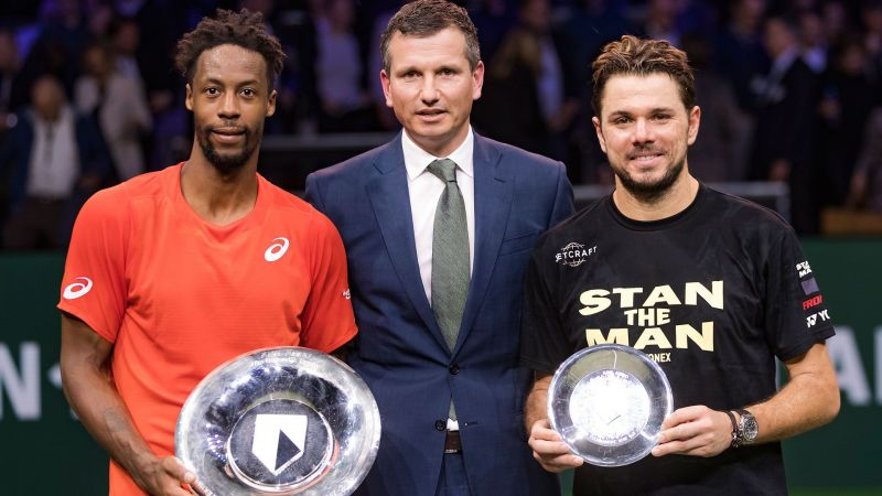 Gael Monfils and Stan Wawrinka with the winner and runner up trophies at Rotterdam-2019