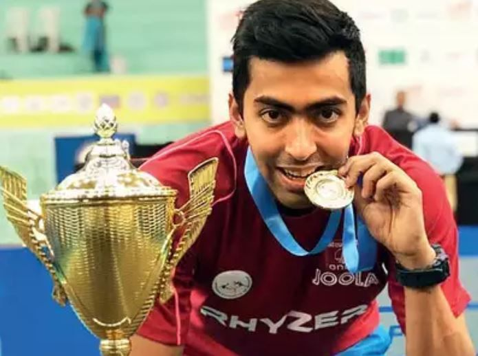 Harmeet with his National Championships title (Courtesy: Ahmedabad Mirror)