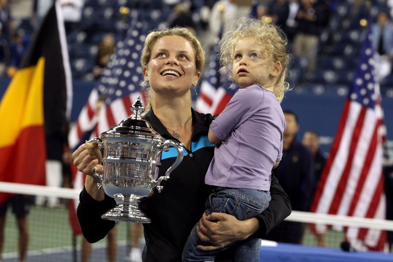 Clijsters with her daughter after winning the US Open in 2010