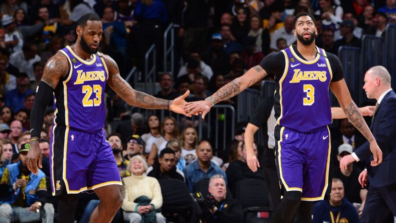 LeBron James and Anthony Davis help the Lakers improve to 7-0 on the road in their purple Statement unis
