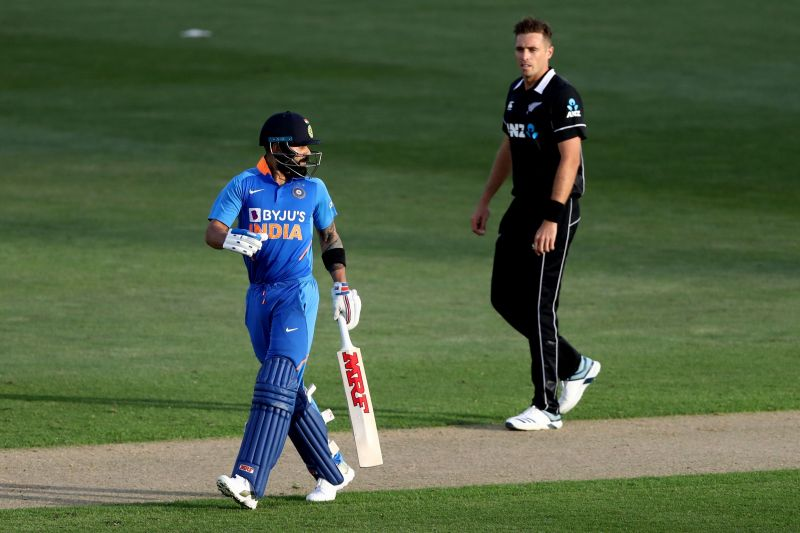 Virat Kohli walks back after being cleaned up by Tim Southee.