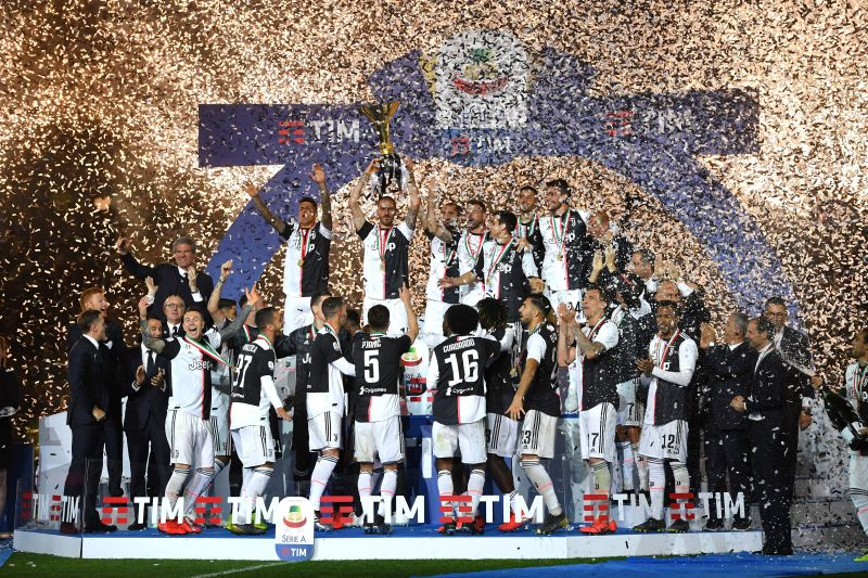 Juventus players celebrating with the 2018-19 Serie A Title