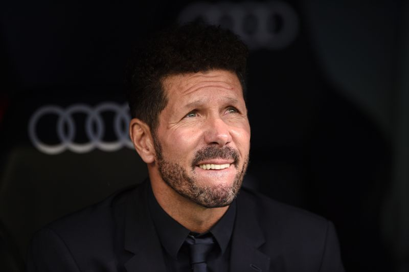 Diego Simeone watches on as his side lose to rivals Real Madrid.