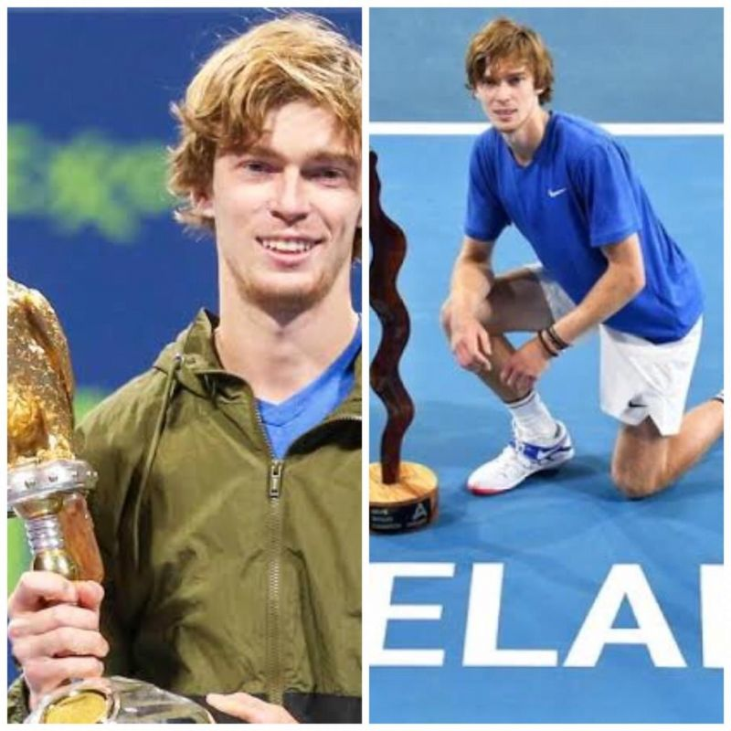 Andrey Rublev poses with his Doha (left) and Adelaide titles