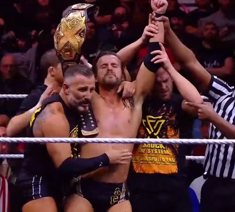 Adam Cole retains the title with slight assistance from Johnny Gargano