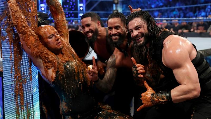 Roman Reigns and The Usos slathered dog food all over King Corbin!