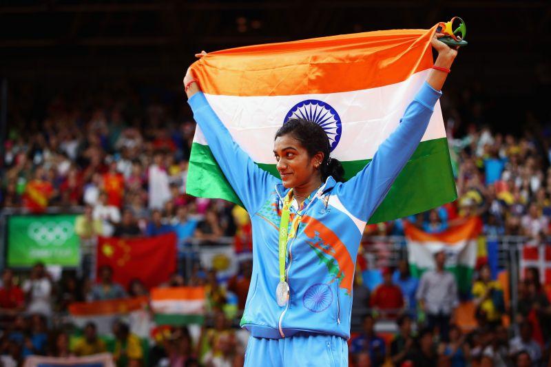 PV Sindhu proudly raising the Indian flag